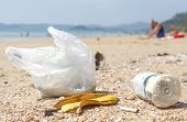 picture of environmental pollution  - Garbage on a beach environmental pollution concept picture - JPG