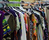 picture of flea  - vintage clothes hanging in the open flea market - JPG