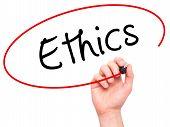 stock photo of ethics  - Man hand writing Ethics on visual screen - JPG