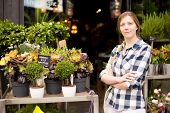 pic of flower shop  - business woman standing outside her flower shop - JPG