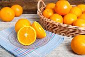 pic of valencia-orange  - still life of oranges on wicker and wood background - JPG