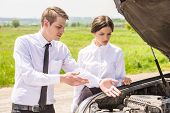 picture of argument  - Business couple having argument by broken car at countryside - JPG