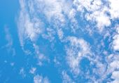 stock photo of windy  - Gray and white clouds on blue sky in windy weather - JPG