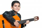 image of hispanic  - Cute hispanic boy playing an acoustic guitar isolated on a white background - JPG