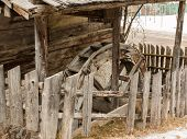 stock photo of water-mill  - abandoned historic old wooden water mill house waterwheel - JPG