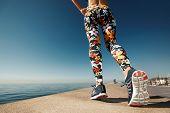 stock photo of jogger  - Runner woman feet running on road closeup on shoe - JPG