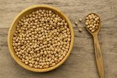 picture of chickpea  - bunch of chickpeas in a bowl and spoon on old wooden background - JPG