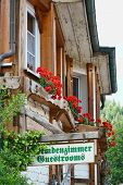 stock photo of guest-house  - Guest Rooms Sign on wooden board on a guest house in the Black Forest - JPG