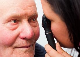foto of cataracts  - Optician checking elderly patient - JPG