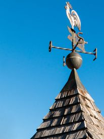 stock photo of wind vanes  - weathercock weather vane wind direction decoration on a roof top - JPG