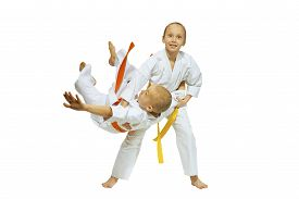 image of judo  - Children are training judo throws on the white background - JPG