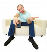 pic of televisor  - emotional man with a TV remote control sitting on the couch - JPG