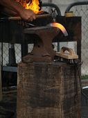picture of clydesdale  - A red hot shoe on the anvil being shaped by the blacksmith - JPG