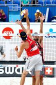 PRAGUE - JUNE 19: Rosenthal(USA) in attack & Phill Dalhausser(USA) on the block at SWATCH FIVB World