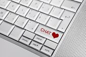stock photo of long distance relationship  - Silver keyboard with heart icon and CHAT text on keys - JPG