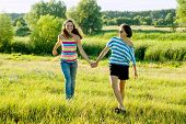 Parent And Teenager, Happy Mother And Teen Daughter 13, 14 Years Old Hold Hands Go Laugh Talk. Backg poster
