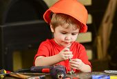 Child In Hard Hat, Helmet Playing With Hex Bolts As Builder Or Repairer, Handcrafting. Toddler On Bu poster