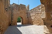 stock photo of parador  - Ancient Moorish Gate of a Parador - JPG