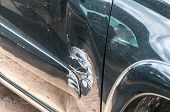 Damaged Car. Black Scratched Car With Damaged Paint In Crash Accident On The Street Or Collision On  poster