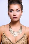 Young beautiful brunette woman with beads. Young beautiful brunette poster