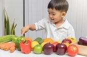 Healthy And Nutrition Concept. Kid Learning About Nutrition How To Choose Eating Fresh Fruits And Ve poster