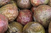 Dried Passion Fruit Bunch On Market, Closeup Photo. Passion Fruit Texture. Red And Brown Exotic Frui poster