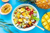 Fruit Salad With Tropical And Exotic Fruits On Blue Background. Healthy Fruit Salad. Tropical Fruits poster