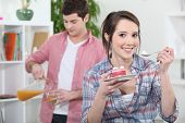 picture of concubine  - Euphoric woman eating cake - JPG