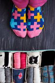 Feet Selfie With Colorful Socks And A Socks Organizer On A Dark Wooden Background. Top View poster