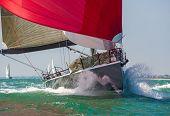 Close up of sailing boat, sail boat or yacht at sea with red sails poster