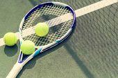Tennis balls on a tennis court poster