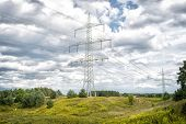 Power Towers On Natural Landscape. Transmission Towers On Cloudy Sky. Electricity Pylon Structure Wi poster