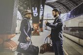 Two Happy Multi-ethnic Bearded Businessmans Together Wearing Casual Clothes And Holding Travel Bags  poster