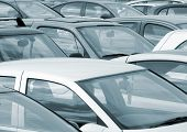 stock photo of parking lot  - Telephoto view of cars parked in parking lot - JPG