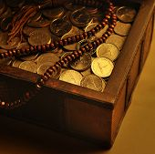 stock photo of dirhams  - UAE Dirham coins in a trunk and wooden rosary - JPG