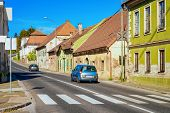 Car On Road With Crossroads In Slovenska Bistrica poster