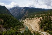 Aerial View Of A Scenic Dirt Road Towards Gold Bridge In The Valley Surrounded By Canadian Mountain  poster