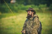 Portrait Of Cheerful Senior Man Fishing. Guy Fly Fishing. Catching And Fishing. Male Hobby. Rural Ge poster