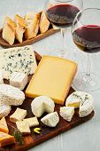 French Cheese Plate And A Glass Of Wine For Buffet Party. Traditional French Or Italian Entires poster