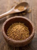 stock photo of fenugreek  - close up of a bowl of fenugreek seeds - JPG