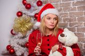 Lonely Woman With Teddy Bear Toy And Champagne Glass Christmas Eve. Nostalgic Moments. Melancholy Em poster