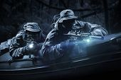Two Fighters Of A Special Unit Move Through The Forest At Night. The Concept Of Special Operations, poster
