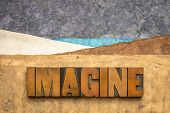 imagine concept in vintage letterpress wood type against abstract mountain landscape created with ha poster