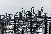 High Voltage Electrical Substation Tower Top, Close Up On A Closed Electrical Isolator Or Electrical poster