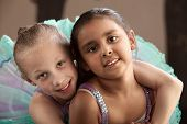 image of bff  - Young ballet student gives her friend a hug - JPG