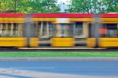 Yellow Tram With Motion Blur Effect Moves Fast In The City. High Speed Passenger Train In Motion On  poster