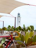 La Mola lighthouse in formentera with bicycle in foreground poster
