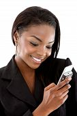 stock photo of people talking phone  - Business woman sending a text message on her mobile phone  - JPG