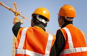 stock photo of vest  - Site manager with safety vest discussion under construction - JPG