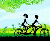 Girls Riding Tandem Bicycle